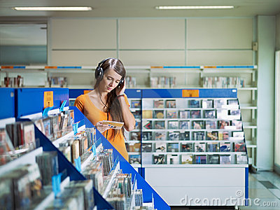 girl-listening-music-cd-store-16756503